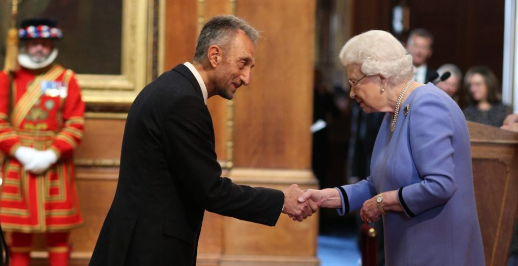 Dr. Mike Ashmead is made an OBE (Officer of the Order of the British Empire) by Queen Elizabeth II at Windsor Castle. Photo credit Jonathan Brady/PA Wire